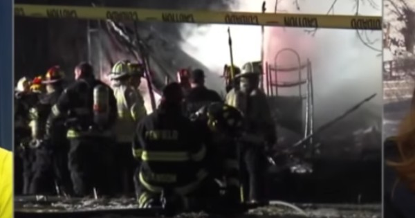 firefighters fighting mobile home fire