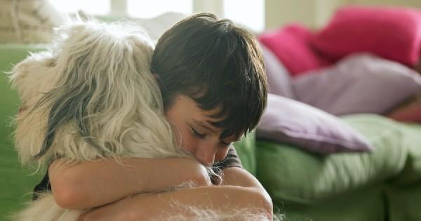 boy hugging a dog