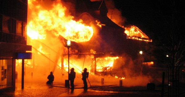 firemen fighting building fire