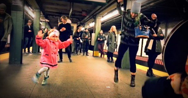 Little Girl Dancing in NYC While Waiting for the Subway