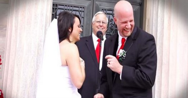First Kiss At A Wedding Is Hilariously Interrupted By A Child