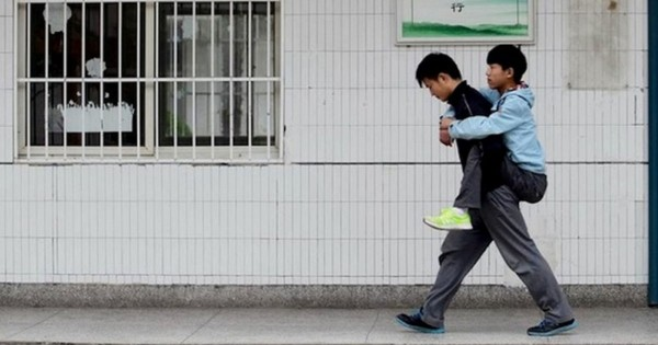Friend Carries to School Student with MS Top of Class