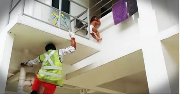 Man Saves A Toddler Dangling Off The Ledge Of A Building