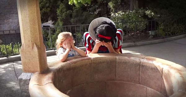 Toddler Is Surprised By Her Daddy At Snow White's Wishing Well