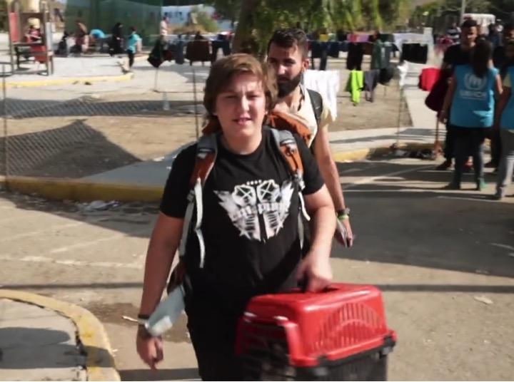 mj-godupdates-teen-refugee-brings-dog-2