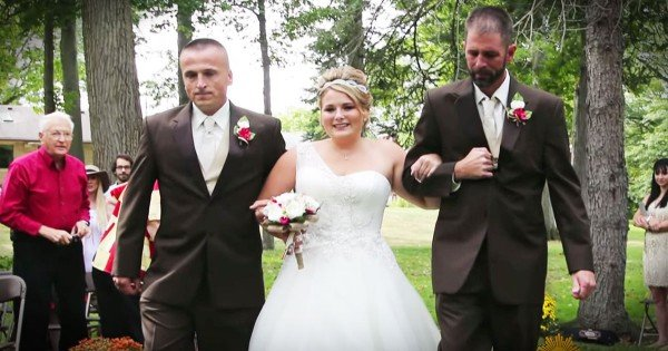 Bride's Dad And Step Dad Walk Her Down The Aisle At Her Wedding