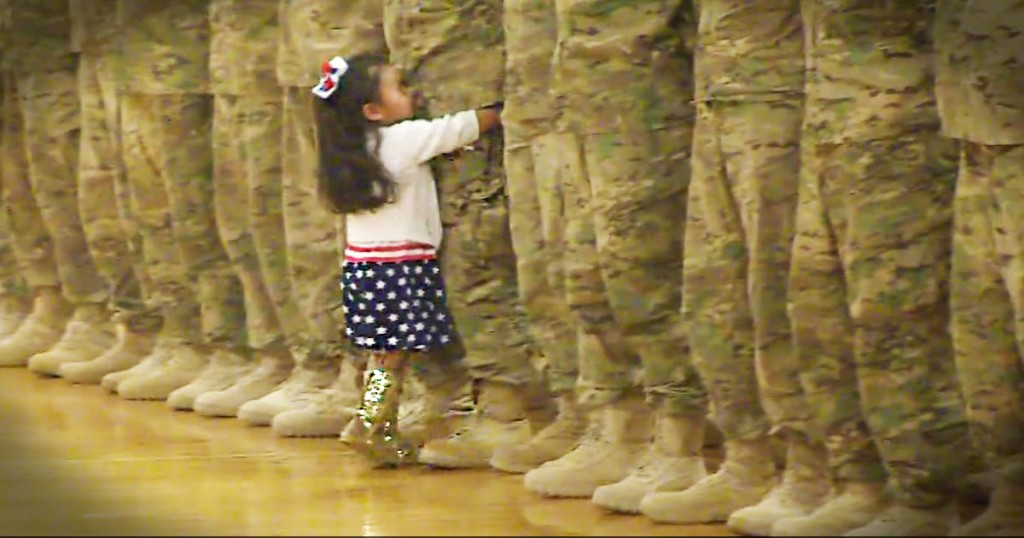 jd-godvine-little girl runs to hug soldier daddy-FB