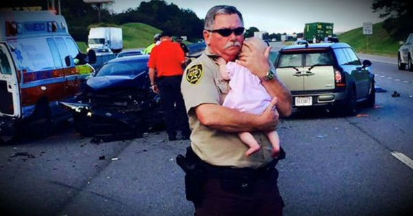 Police Officer Holds Baby Girl After Car Accident