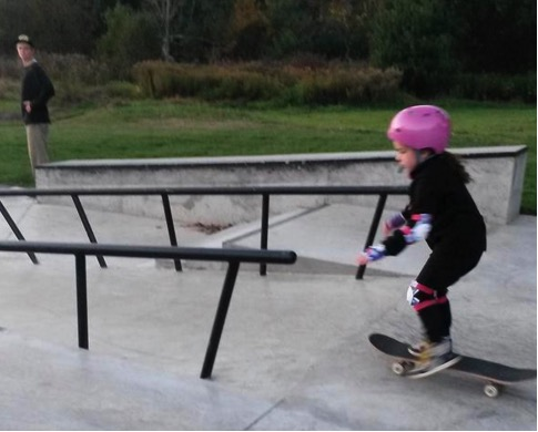 mj-godupdates-teen-boy-helps-girl-skateboard-3