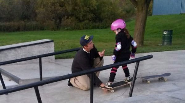 mj-godupdates-teen-boy-helps-girl-skateboard-4
