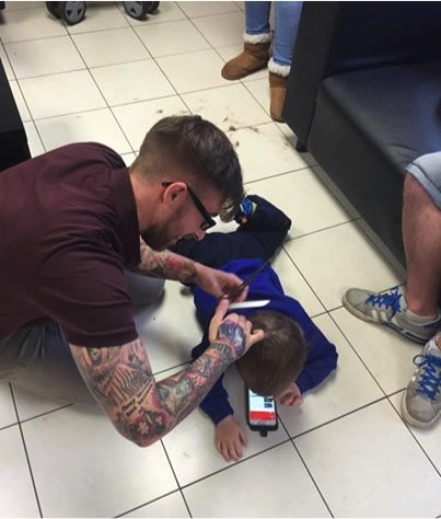 mj-godupdates-barber-cuts-boy-with-autism-hair-on-floor-1