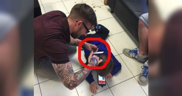 Barber Lays On The Floor For A Boy With Autism's Haircut