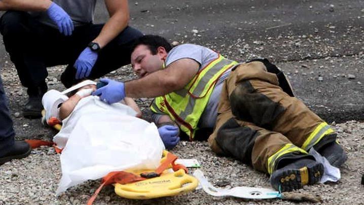 mj-godupdates-firefighter-plays-happy-feet-for-boy-at-crash-2