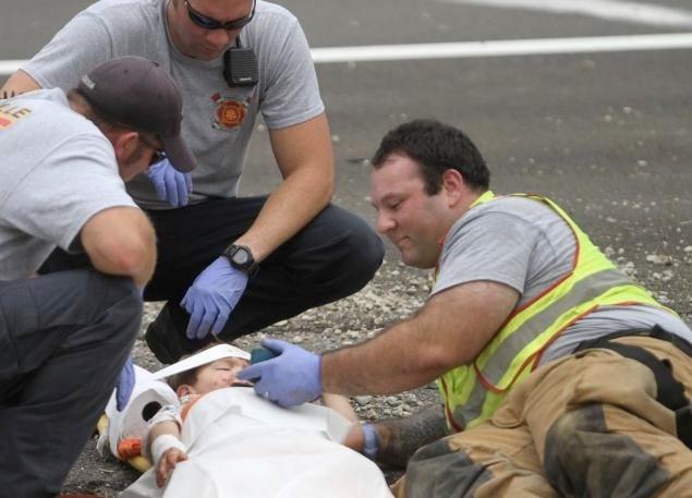 mj-godupdates-firefighter-plays-happy-feet-for-boy-at-crash-4