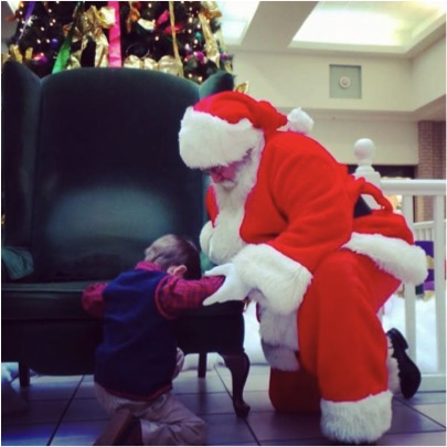 godupdates boy prays with santa for miracle for baby 1