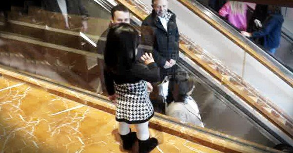 Little Girl Says Bye To People On Mall Escalator