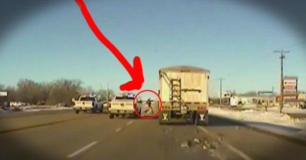 Police Officer Jumps Onto A Moving Truck To Save The Driver