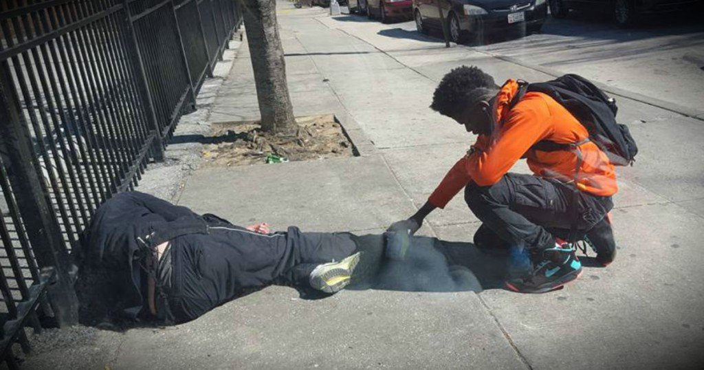 godupdates officer sees teen pray over homeless man fb