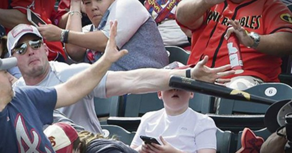 Dad's Quick Action Saves Son From Flying Baseball Bat