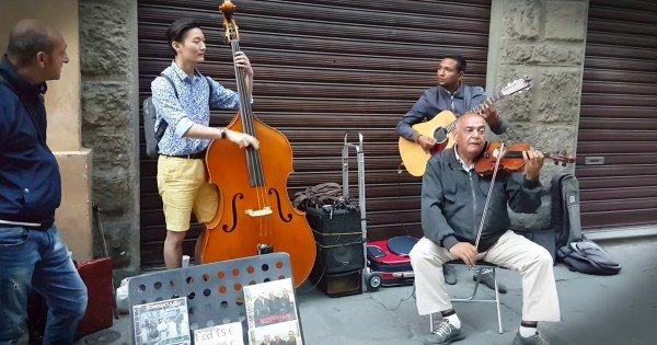 Tourist Plays With Jazz Street Musicians in Florence Italy