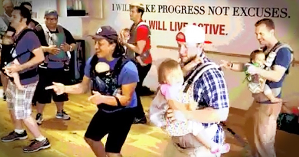 dads dance with babies at dance studio GodUpdates