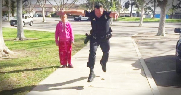 Police Officer Plays Hopscotch with Homeless Little Girl