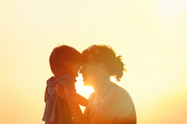 happy mother and son at sunset