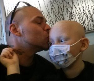 godupdates dad gets tattoo to match son's cancer surgery scar