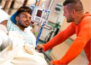 godupdates football star tim tebow visits friend in hospital 2