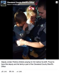 godupdates photo of kids praying for police officer dad 1