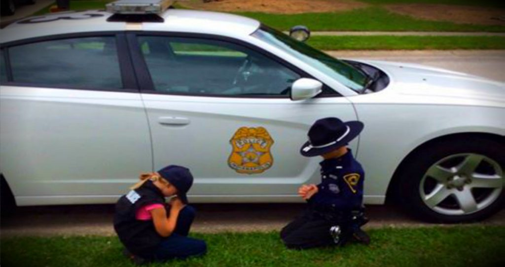 godupdates photo of kids praying for police officer dad fb