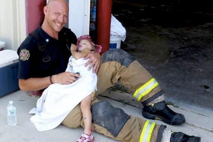 godupdates viral photo smiling firefighter 4