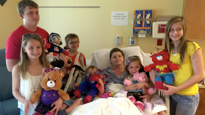 godupdates woman honors promise to adopt dying friend's 6 kids 3