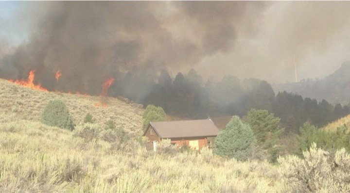 godupdates mysterious figure photo cabin spared in idaho fire 1