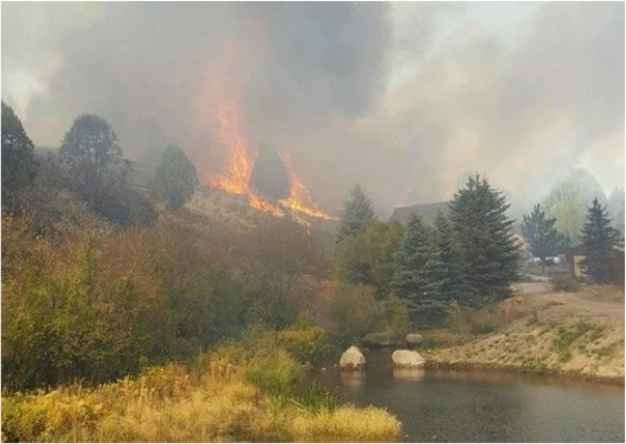 godupdates mysterious figure photo cabin spared in idaho fire 3