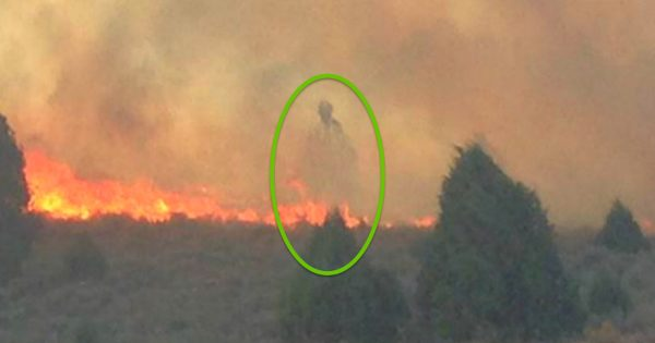 Mysterious Figure Appears Over Cabin Miraculously Spared From Raging Fire