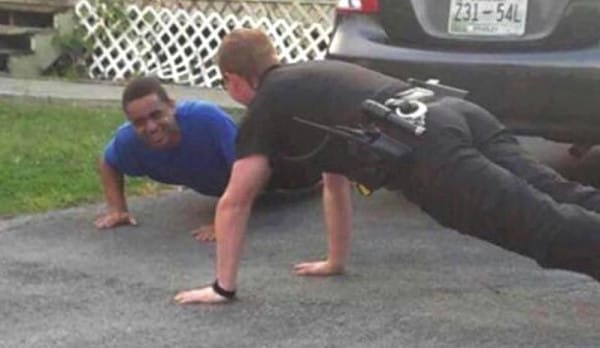 godupdates police officer does push-ups to calm boy with autism 3