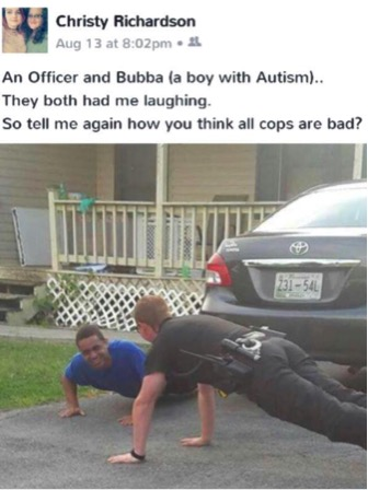 godupdates police officer does push-ups to calm boy with autism 4