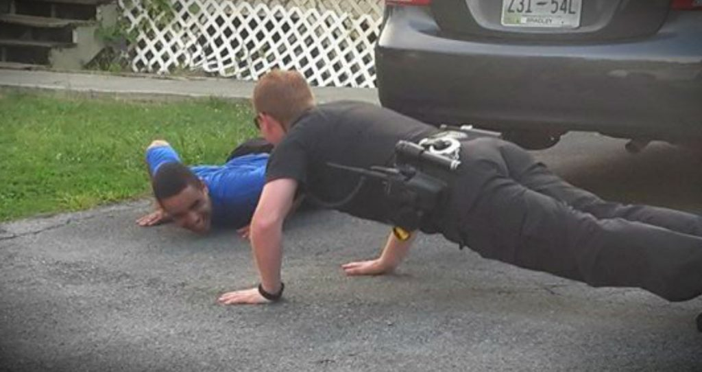 godupdates police officer does push-ups to calm boy with autism fb