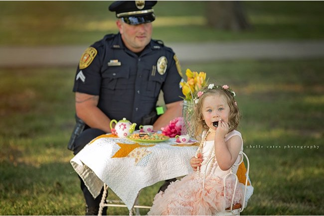 godupdates police officer joins tea party with little girl he saved 1