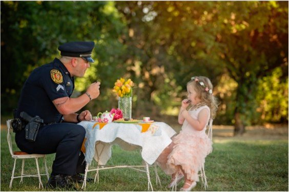 godupdates police officer joins tea party with little girl he saved 4