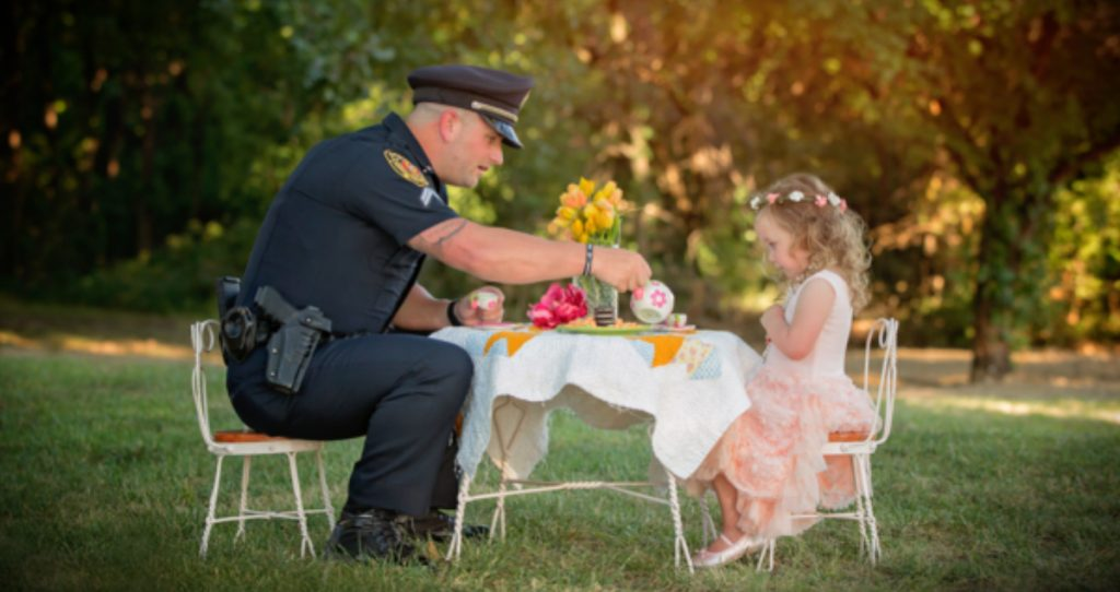 godupdates police officer joins tea party with little girl he saved fb
