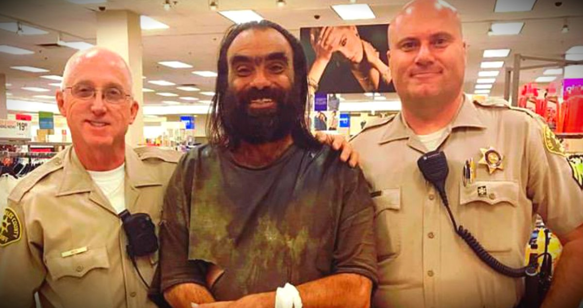 godupdates 2 police officers walk homeless thru store to buy clothes fb