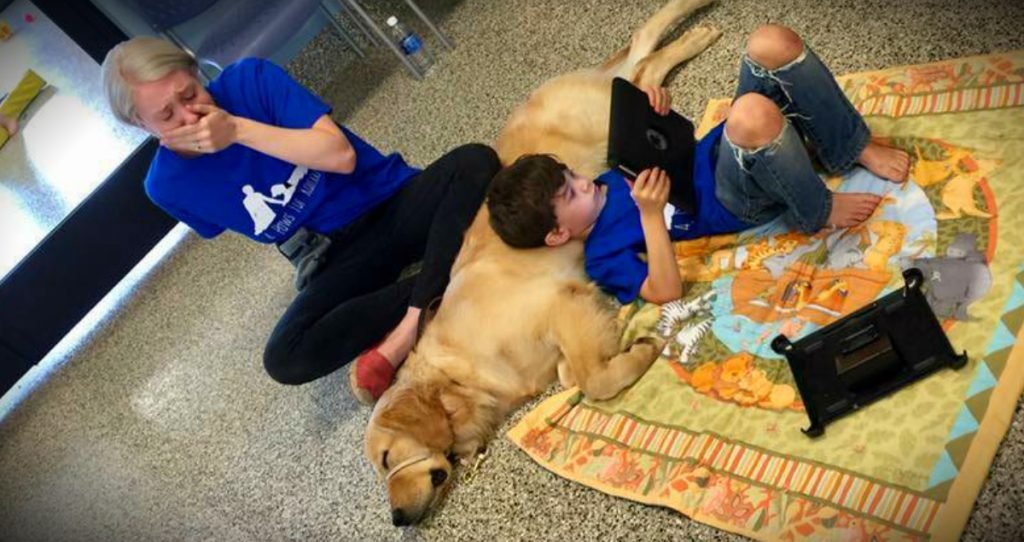 godupdates mom cries when son with autism meets his autism service dog fb