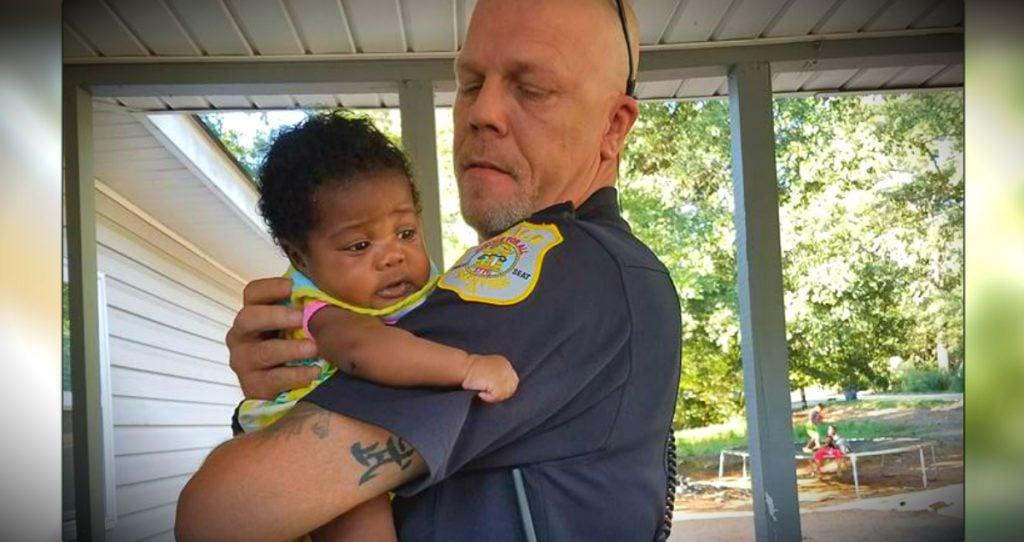 godupdates police officer credits god after saving choking baby fb