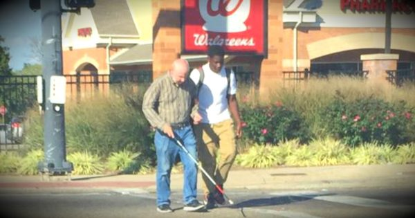 Teen Helps A Blind Man Cross A Busy Intersection