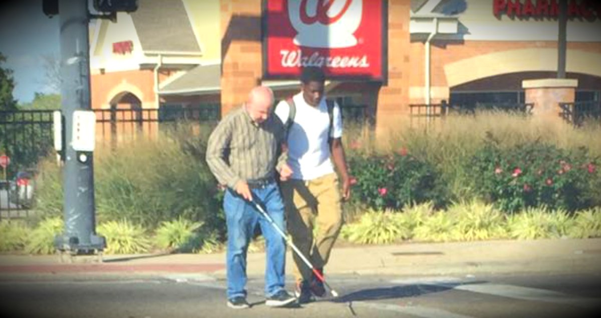 godupdates teen helps blind man cross a busy intersection fb