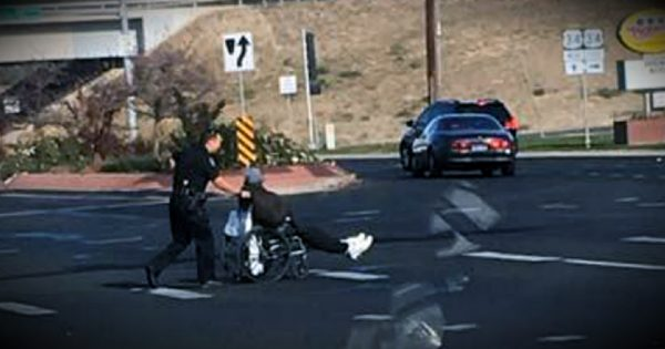 Officer Parks At Busy Intersection To Help A Man In A Wheelchair Cross