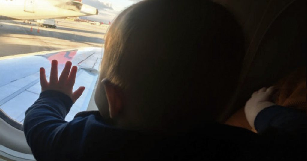 godupdates stranger held an exhausted dad's son on plane fb