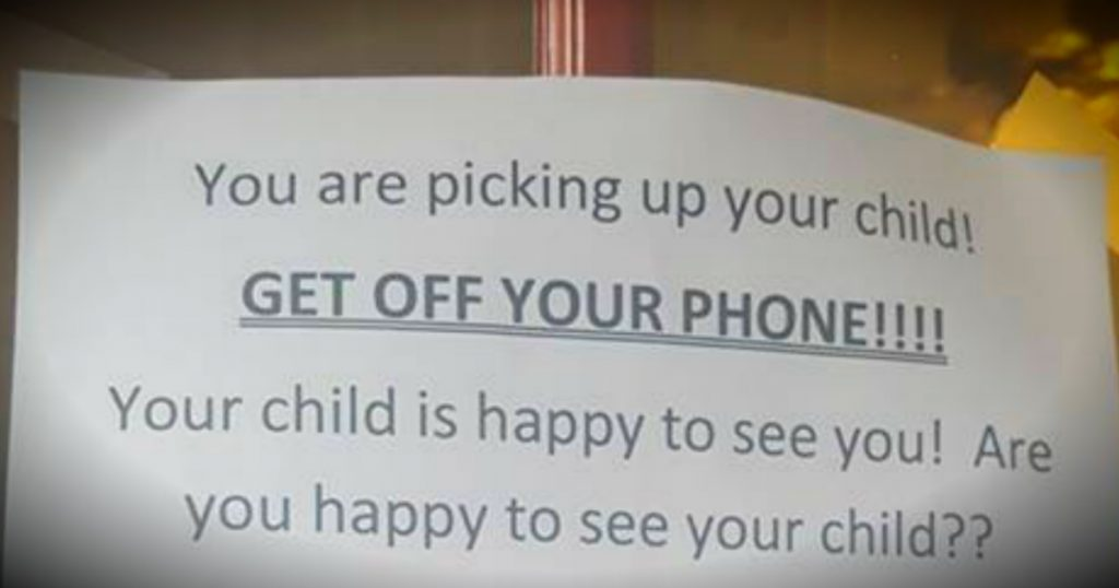 godupdates day care's sign for parents to get off phone goes viral fb